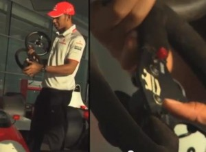Lewis Hamilton shows the evolution of the McLaren Steering Wheel